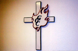 Greater Grace Church logo, a flaming cross.